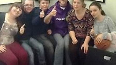 Papworth Trust youth club leader Nick Butler with some of the club members