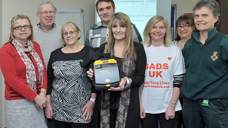 lifesaving equipment donated to Wisbech Citizens Advice Bureau from the cardiac charity SADS UK. Cen