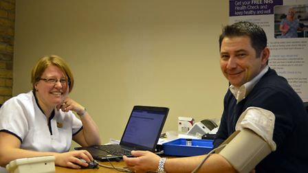 Stuart Warren from Priden Engineering has his health checked by Frances Salter, part of the Health C