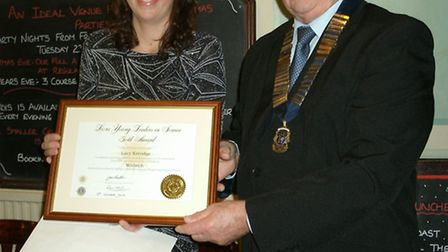 Lucy Kerridge receives her certificate from Lions president Ray Hill.