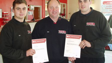 Gary Robinson (centre) presenting awards to Thomas Plumb (left) and James Robinson (right).