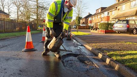 A council worker carries out pothole repairs