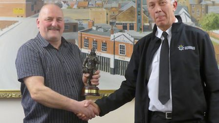 Graham Brighty is presented with figurine by area commander Maurice Moore