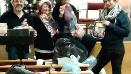 Russell Day, Kerri Ann Horn, Alison Day and Ross Bennington with bags of new toys.