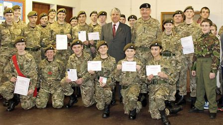 Richard Barnwell DL stands with Capt Trevor Longmuir (Detachment Commander) surrounded by the Cadets