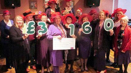 The Gadabout Girls present a cheque for £3,160 to macMillan.