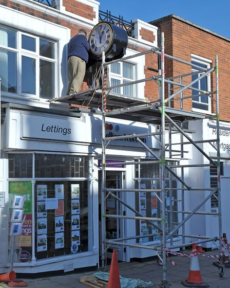 Dann's Clock is being installed over WH Brown on Bridge Street Wisbech. Picture: Steve Williams.