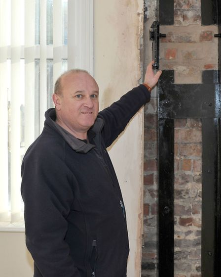 Dann's Clock is being installed over WH Brown on Bridge Street Wisbech. Ray Johnson chairman of the
