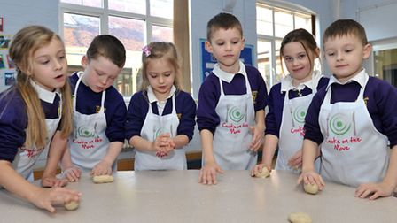 Cooks on the move at Nene Infant School, Wisbech. Year 2 pupils baking. Picture: Steve Williams.