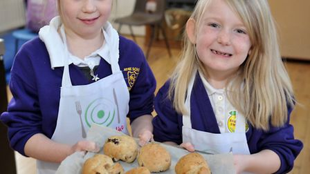 Cooks on the move at Nene Infant School, Wisbech. Saffron and Tiana showing the finished scones. Pic