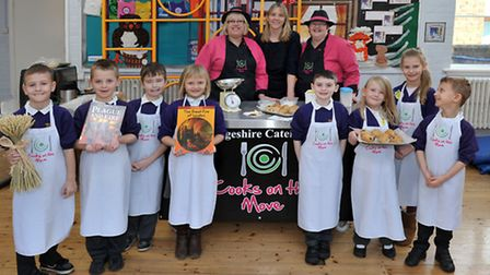 Cooks on the move at Nene Infant School, Wisbech. Year 2 pupils with Carol Youngman, teacher Sally K