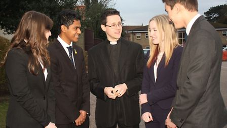 The Rev Philip Hobday (centre) meeting pupils who attended the talk. Picture: TIM CHAPMAN.