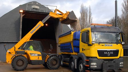 A gritter lorry is loaded up with salt