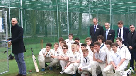 Matt Prior cutting the ribbon to open the nets while Spalding Grammar School cricketers look on.