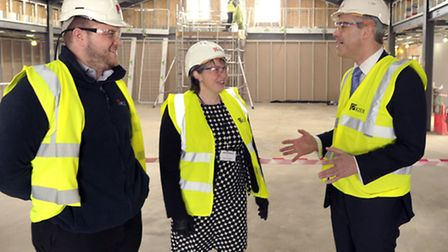Lee Collins and Nicola Parker show Steve Barclay the project.