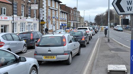 The new link road/river crossing would reduce congestion in the town centre.