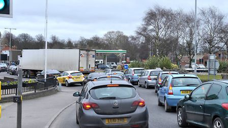 Traffic queuing around Freedom Bridge roundabout to join Lynn Road.