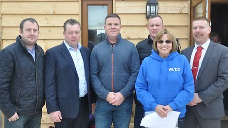 Vice chairman Sue Picture flanked by local businessmen responsible for the new clubhouse.