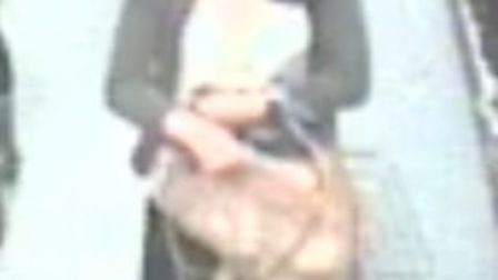 CCTV image of woman police want to speak to in connection with Norfolk theft.