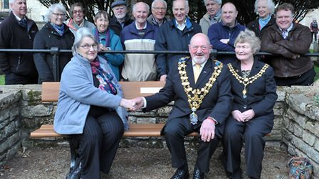 Wisbech Society unveils its 75th anniversary bench in the gardens of St Peter & St Paul church. Left