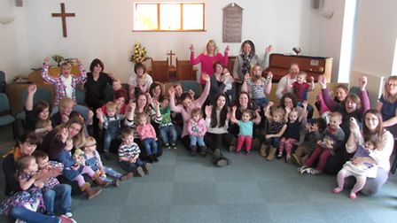 """Children and staff at Terrington St John Pre-School celebrate their """"outstanding"""" Ofsted."""