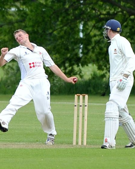 Sam Rippington bowling for Wisbech. Picture: Steve Williams.