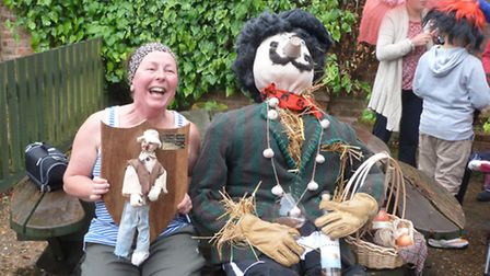 Mrs. Christine Brennan, Lime Avenue, Elm, with her winning scarecrow Pierre