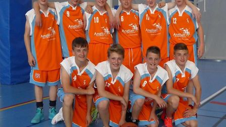 Marshland High School basketball team in their new kit sponsored by Anglian Home Improvements.