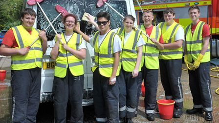 """Charity car wash with Princes Trust students and firefighters at Wisbech fire station. Picture: Ste"