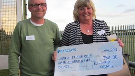 Wisbech and District Stroke Club member Kevin Stenton with his wife Pat showing off the cheque recei
