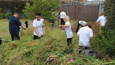 Lloyds workers help out at Community House.