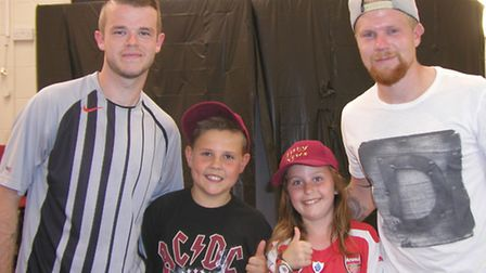 Fishy News reporters Lucas and Ellie with Wisbech Town players.