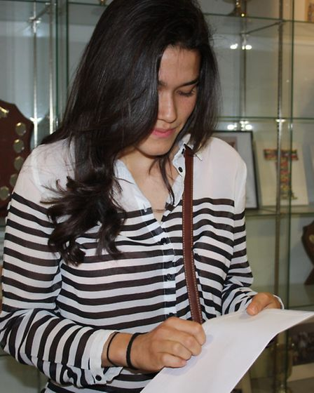 Mayra Brandao opening her results envelope which contained 2 A grades and 2 B grades.