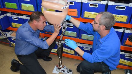Billy Lee's new bionic leg being tested by (left) Billy's prosthetist Shaun Annandale and right seni