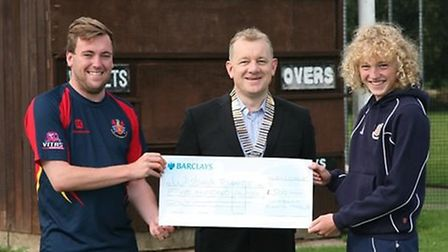 Sam Smith, centre, presenting the cheque to Shane Sleath and under 13 Wisbech player Alex Bishop.