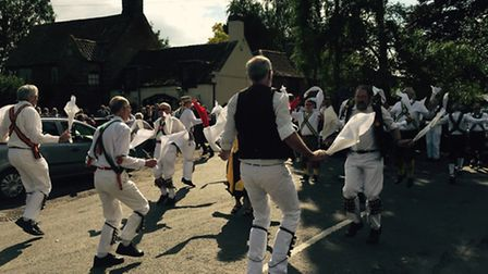 Morris men dance to pay their respects to one of their own, after the funeral. Pictures submitted