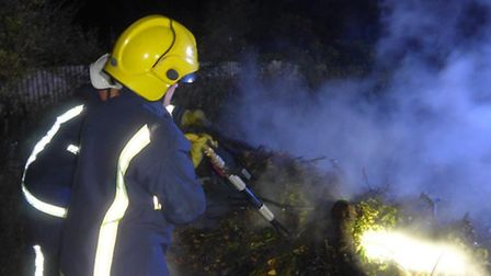 Firefighters tacke an out of control bonfire in Wisbech. Picture: FACEBOOK CAMBS FIRE.