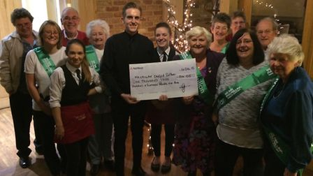 Members of the fundraising group with restaurant staff at the recent cheque presentation.