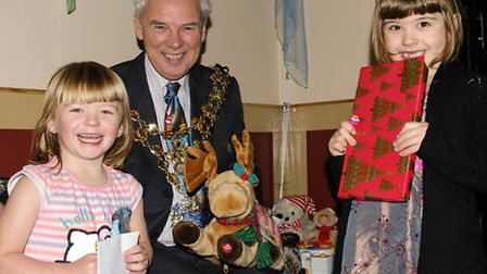 Mayor of Wisbech David Hodgson with children at Santa's Grotto