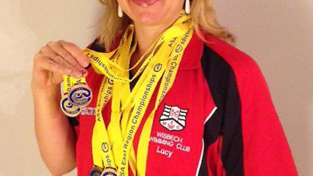 Wisbech Swimming Club's Lucy Ryan with the six goild medals she won at the ASA East Region, Open Mas
