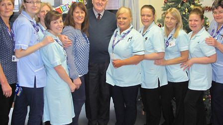 Happy 90th: Wally (centre) is pictured with the ward staff
