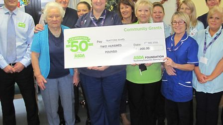 Jane Bates (right) from Asda presents ward manager Sandra Dade (left) with a cheque