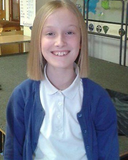 Millie Cousins after having 20 inches cut off her hair for charity last month.