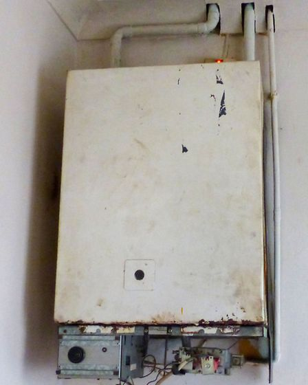 A boiler in the hallway of the house in Colvile Road, Wisbech, in a poor condition.