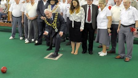 Hudson Indoor Bowls Club members look on after Councillor David Hodgson's throw. Picture: Steve Will
