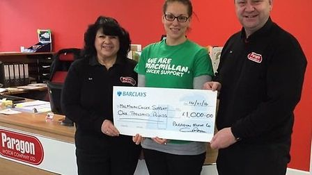 Paragon Motors present a cheque to Macmillan Cancer Support