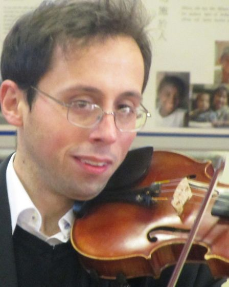 Violinist, Jacob Keet performs at St. Peter's coffee morning and baroque Christmas carols event