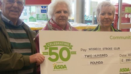 Wisbech Stroke Club members Peter and Barbara Fewster and Dorothy Pepper receiving the cheque from J