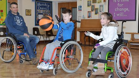 Go Kids Go wheelchair event at St Peters Junior School, Left: Barry Clarke, Sophie Clarke and Lewis