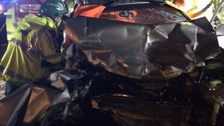 A woman had to be cut from her vehicle following a three vehicle crash involving a telegraph pole at